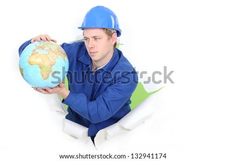 Tradesman holding a globe - stock photo