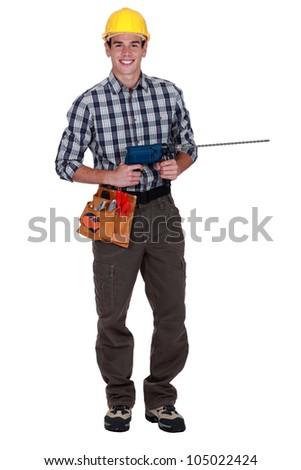 Tradesman holding a power tool - stock photo