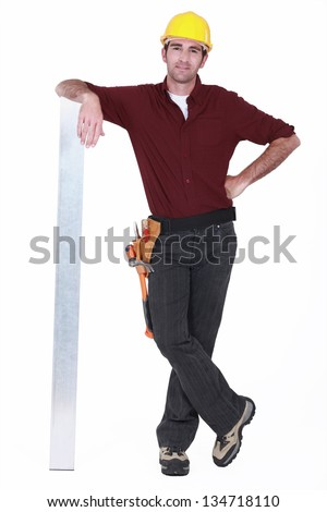 Tradesman leaning against a girder - stock photo