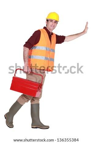 Tradesman pushing an invisible wall - stock photo