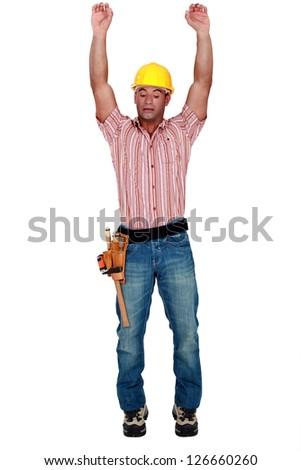 Tradesman stretching - stock photo