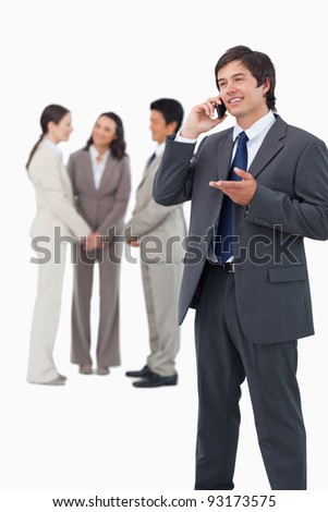 Tradesman talking on the phone with team behind him against a white background