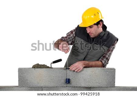 Tradesman using a plumb-bob - stock photo