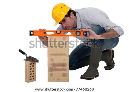 Tradesman using a spirit level - stock photo