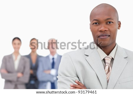 Tradesman with team behind him against a white background - stock photo