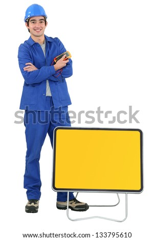 Tradesman with traffic sign - stock photo