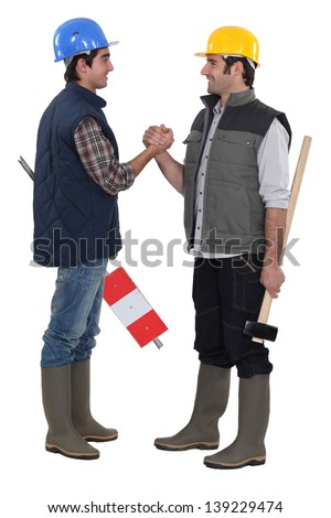 Tradesmen forming a pact - stock photo