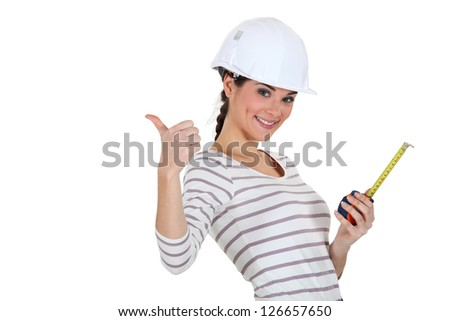 Tradeswoman giving the thumb's up - stock photo