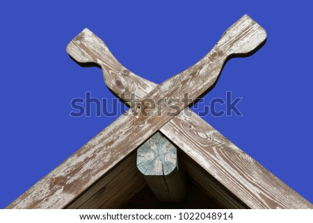 Tradicional roof symbol isolated on blue surface.