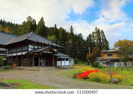 Tradition japanese house in Akita, Japan. Around the house is a pine forest mountain and Japanese garden. Cloudscape and blue sky.