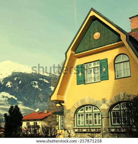 Tradition mountain house on winter ski resort in Alps(Austria),square toned image, instagram effect - stock photo