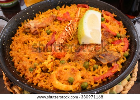 Tradition Seafood Spanish Paella in Pan, this is a typical spanish dish. - stock photo