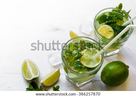 Tradition Summer drink mojito with lime and mint. Top view with copy space. - stock photo