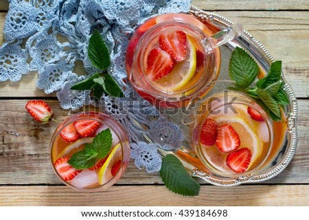 Tradition Summer mojito drink with lemon and mint with copy space on a wooden rustic table. Top view. - stock photo