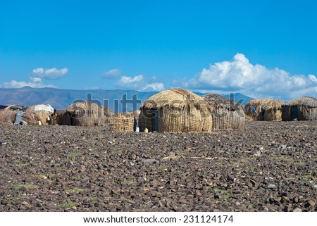 traditional african huts,  EL Molo , Lake Turkana, Kenya  - stock photo