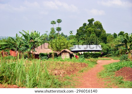 Traditional african huts in a village of countryside, Uganda - stock photo