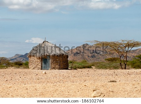 Traditional african huts in Kenya  - stock photo