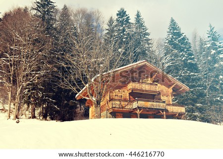 Traditional alpine cabin in the mountains of the Swiss Alps, Switzerland, with added vintage filter effect.   - stock photo