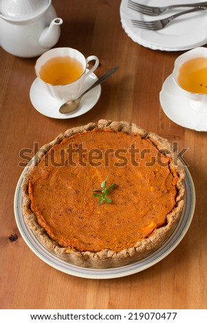 Traditional American and Canadian pumpkin pie for Thanksgiving day. Healthy vegan pie with whole-wheat flour
