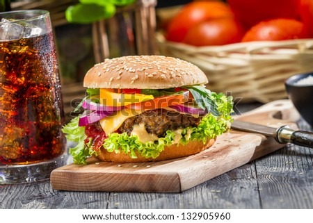Traditional American breakfast made up of hamburger and a coke - stock photo