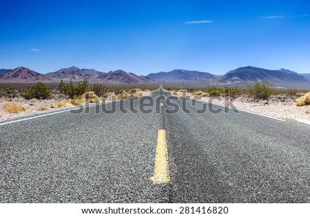 Traditional American Highway Among High Mountains to Death Valley Area. Horizontal Image Composition - stock photo