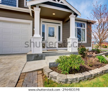 Traditional american home with nice lawn and white trim. - stock photo