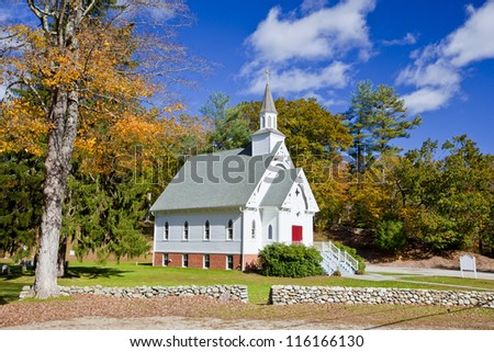 Traditional American white church in the fall - stock photo