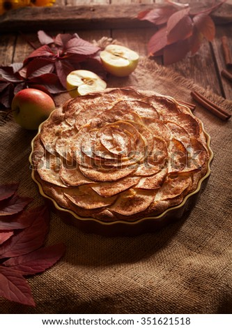 Traditional American winter holiday celebration apple pie sweet backed dessert food with cinnamon and apples on vintage table background. Autumn decor.  Rustic style and natural light. - stock photo