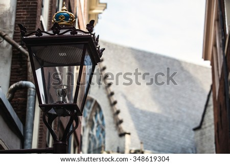 Traditional ancient street lamp on stone wall.