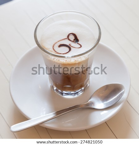 Traditional and artistic Italian coffee with milk and decoration - stock photo