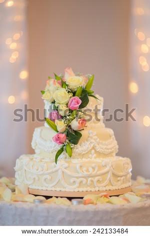 traditional and decorative wedding cake at wedding reception.  - stock photo