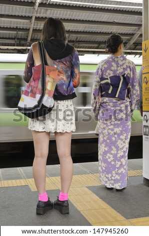 Traditional and modern fashion  An urban scene commonly encountered in Japan  - stock photo