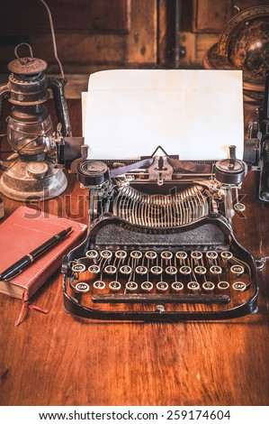 Traditional and old way of writing messages and taking photos, typewriter, camera, watch, pen, Vintage lamp on the desk - stock photo