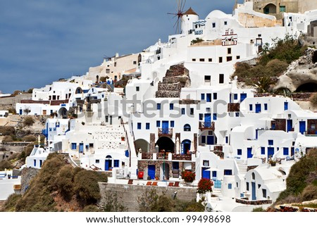 Traditional and picturesque village of Oia at Santorini island in Greece - stock photo