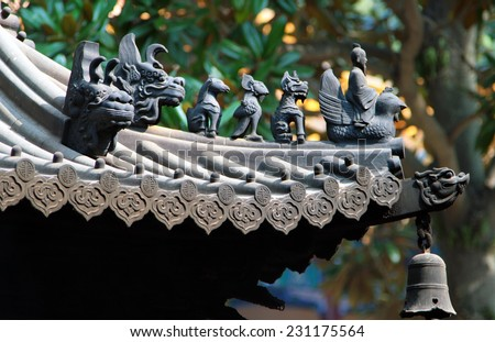 Traditional animal figures on the roof of chinese temple - stock photo