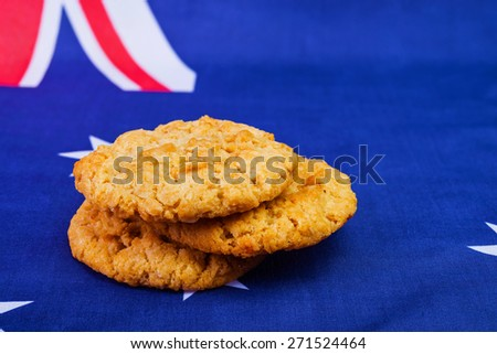 Traditional  Anzac biscuits on  Australian flag as background - stock photo