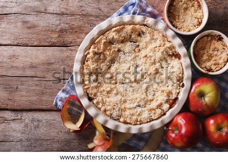 Traditional apple crisp close-up in baking dish. view from above horizontal, rustic style