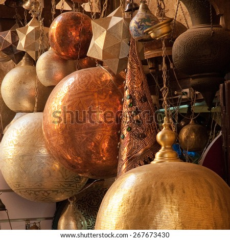 Traditional arabic brass lampshades on display in traditional market in Cairo, Egypt - stock photo