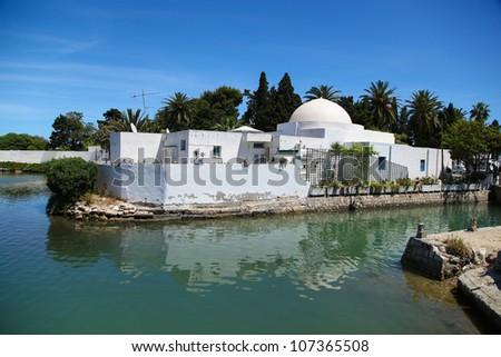 Traditional Arabic house in Tunisia near Lake Carthage - stock photo