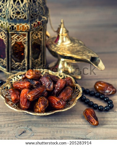 Traditional arabic lamp, latern, dates and rosary. Islamic holidays concept. Eid Al Adha mubarak - stock photo