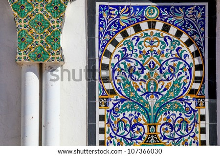 Traditional Arabic Mosaic in Tunisia (Medina). Painted tiles. Colored ornaments - stock photo