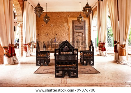 traditional Arabic place for  relax, living room with authentic armchair and decoration - stock photo