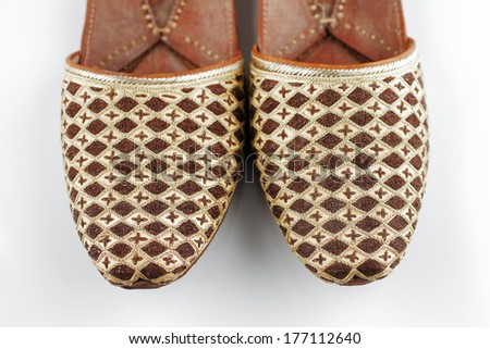 Traditional Arabic slippers shot against a white background - stock photo