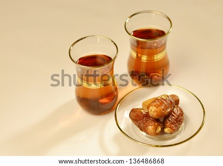 Traditional arabic tea and dates - stock photo