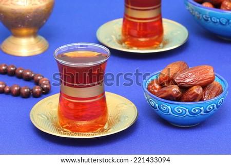 Traditional arabic tea with wood beads - stock photo