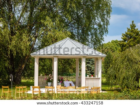 Traditional arbor for wedding ceremony. Wedding arbor for the outdoor wedding in a park - stock photo