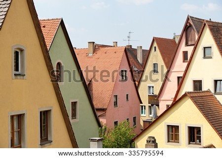 Traditional architecture in Rothenburg ob der Tauber in Germany. It is one of the best-preserved medieval towns in Europe, part of the famous Romantic Road tourist route. - stock photo
