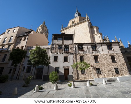 Traditional architecture in the historic centre of Segovia, with the Cathedral in the background, in Segovia, Spain - stock photo