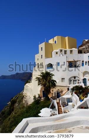 Traditional architecture of Oia village on Santorini island, Greece - stock photo