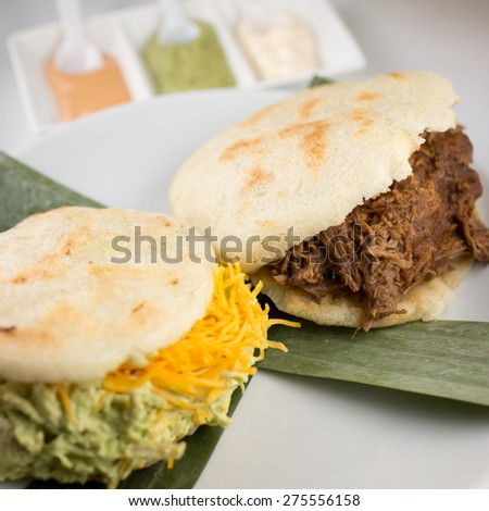 Traditional Arepas. Shredded chicken avocado and cheddar cheese and Carne Mechada, shredded beef.   - stock photo